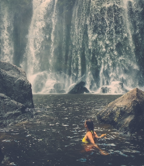 Beautiful woman near waterfall, Phnom Koulen at Siem Reap, Cambodia - Stock Photo - Images