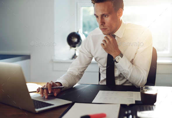 Business man sitting at his desk - Stock Photo - Images