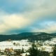 Clouds Moving In The Mountains Above The Houses - VideoHive Item for Sale