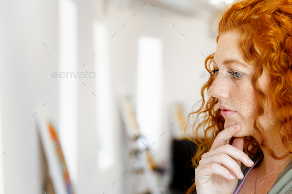 Young caucasian woman in art gallery front of  paintings - Stock Photo - Images