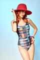 Beauty in swimsuit, hat