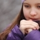 Child Warms Her Hands And Looks At Them In Winter - VideoHive Item for Sale