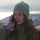 Girl With Snowboard Talking On The Phone - VideoHive Item for Sale