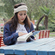 Beautiful Girl is Reading Book in the Park - VideoHive Item for Sale