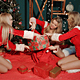 Girls In Santa Claus Costumes Preparing A Gifts - VideoHive Item for Sale
