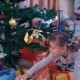 Cute Girl Found Her Gift Under The Christmas Tree - VideoHive Item for Sale