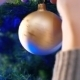 Female Hands Hanging Balls On The Christmas Tree - VideoHive Item for Sale