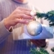 Male Hanging Balls On The Christmas Tree - VideoHive Item for Sale