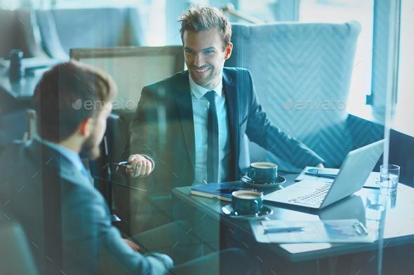 Businessmen communicating - Stock Photo - Images