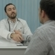 Male Bearded Doctor In Clinic With Male Patient - VideoHive Item for Sale
