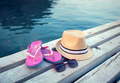 Sunglasses, flip-flops and hat on the wooden texture in summer - PhotoDune Item for Sale