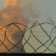 Smoking Chimney Behind Barbed Wire - VideoHive Item for Sale
