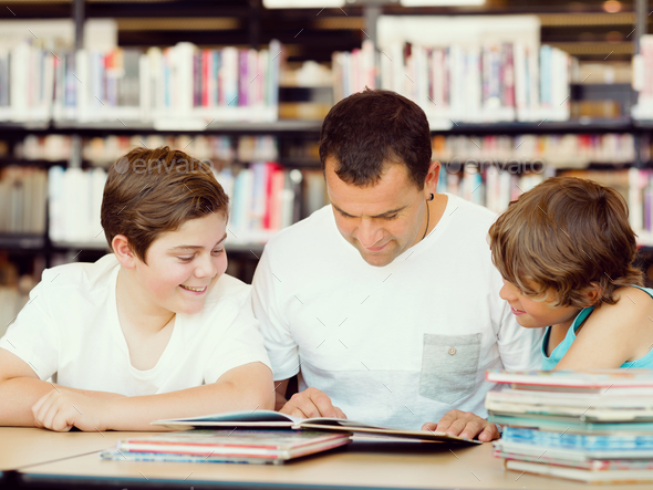 Father with sons in library - Stock Photo - Images