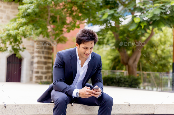Portrait of confident businessman outdoors - Stock Photo - Images