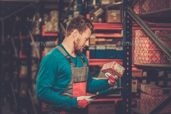 Worker on a automotive spare parts warehouse - Stock Photo - Images
