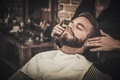 Client during beard and moustache grooming in barber shop - PhotoDune Item for Sale