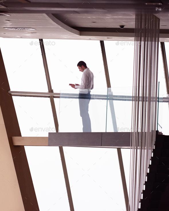 young successful business man in penthouse apartment working on - Stock Photo - Images