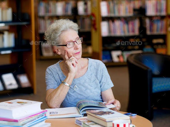 Taking her time with new books - Stock Photo - Images
