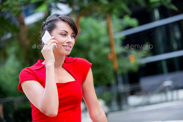 Portrait of businesswoman with mobile phone - Stock Photo - Images