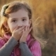 Little Girl In a Sunset Light Blows a Kiss To The - VideoHive Item for Sale
