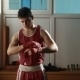 The Young Boxer Pulls Red Bandage On Hands - VideoHive Item for Sale