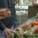 Customers Choosing Tomatoes In The Supermarket - VideoHive Item for Sale