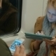Woman In Metro Train Typing In Tablet - VideoHive Item for Sale