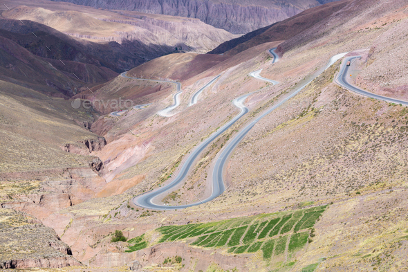 Road in the colored mountain near Purmamarca, Argentina - Stock Photo - Images