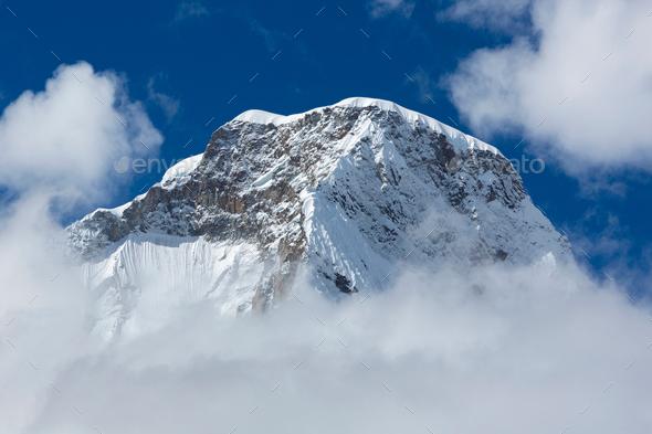 Snow covered mountain peak and blue sky, Cordillera Blanca, Peru - Stock Photo - Images