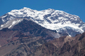 Aconcagua mountain peak with clear blue sky. Argentina - PhotoDune Item for Sale
