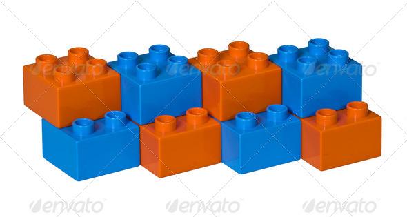 Blue and orange plastic toy bricks - Stock Photo - Images