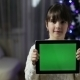 Girl Hold a Tablet Pc With Green Screen - VideoHive Item for Sale