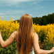 Girl Walking Through Tall Rapeseed Flower Field - VideoHive Item for Sale