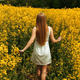 Young Girl Walking Through The Tall Grass of a Field - VideoHive Item for Sale