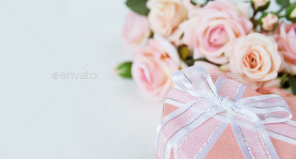 Festive composition with flowers and gift box - Stock Photo - Images