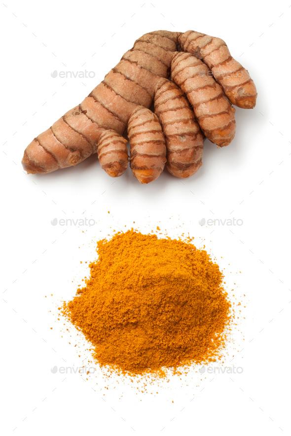 Fresh turmeric rhizome and powder - Stock Photo - Images