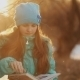 Beautiful Little Girl Reading In Winter Park - VideoHive Item for Sale