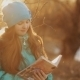 Little Girl In Winter Park Reading a Book - VideoHive Item for Sale