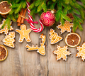 Christmas holiday border with gingerbread cookies, candy cane ov - PhotoDune Item for Sale