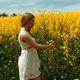 Blond Girl Walking Through The Tall Grass of a Field - VideoHive Item for Sale