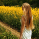 Young Girl Walking Near The Tall Grass of a Field - VideoHive Item for Sale