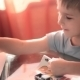 Mom Helping His Son To Do His Homework on Table - VideoHive Item for Sale