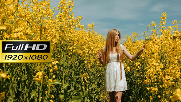 Young girl walking through the tall grass by yurazommer videohive play preview video mightylinksfo