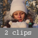 Girl Blows Away the Snow From the Palms in a Sunny Winter Forest - VideoHive Item for Sale