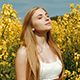 Young Girl Portrait Between Tall Yellow Flowers At Field - VideoHive Item for Sale