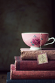 Vintage teacup on stack of old books - PhotoDune Item for Sale