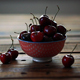 Red Ripe Cherries In Small Bowl On Wooden Table - VideoHive Item for Sale