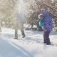 Mom With Two Kids Playing In The Snow - VideoHive Item for Sale