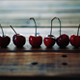 Ripe Red Cherries Placed In Line On Wooden Table - VideoHive Item for Sale