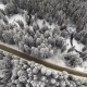 Aerial Shot Of Snow-covered Road In The Countryside Carpathian Mountains - VideoHive Item for Sale